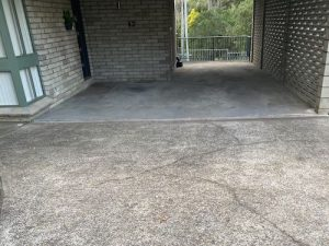 Cracked pebble crete driveway and concrete carport in western sydney